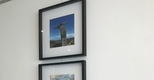 hanging in a column using a picture hanging system